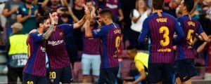 Lionel Messi jublar med sina lagkamrater.