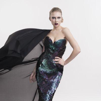 Outi Pyyn suunnittelema trashion-mekko valmiina Linnan juhlia varten