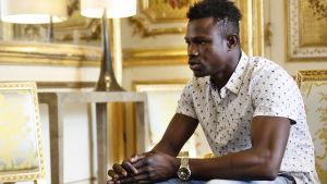 Mamoudou Gassama sitter.