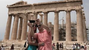 Turister vid Akropolis i Aten den 27 juli 2015.