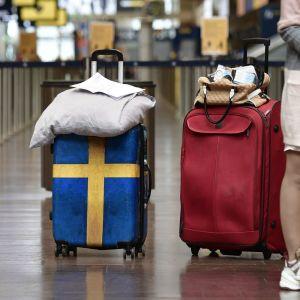 Resenärer på Arlanda flygplats i Stockholm.