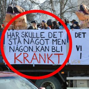 """Utklädda elever på ett lastbilsflak. På sidan hänger två lakan som de skrivit på. På det ena står det """"Här skulle det stå något men någon kan bli kränkt"""". Det det andra står det """"Det kunde varit värre, vi kunde gått i öv*s ;)""""."""