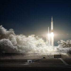 En Falcon Heavy-raket som lyfter.
