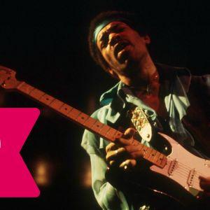 Jimi Hendrix blundar och spelar elgitarr.