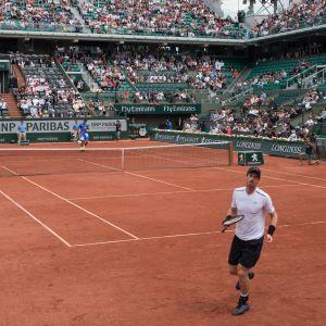 Andy Murray och Juan Del Potro på tennisplanen.