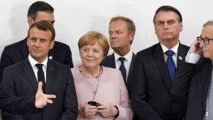 G20-mötet i Osaka 29.6.2019. Emmanuel Macron, Angela Merkel, Donald Tusk, Jair Bolsonaro