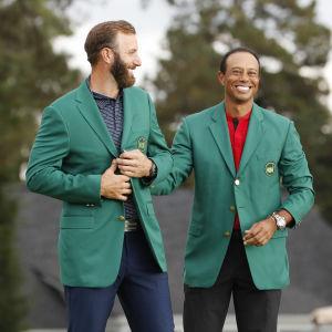 Dustin Johnson och Tiger Woods efter US Masters 2020.