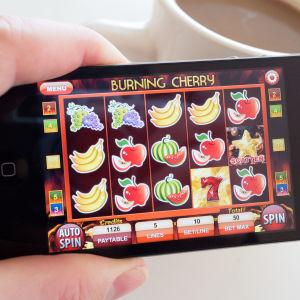 Penningspel på mobilskärm
