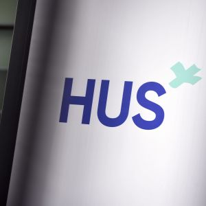 Helsingfors och Nylands sjukvårdsdistrikts logo.