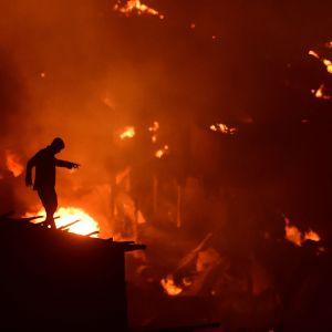 Den stora branden som förstörde 15 000 hem i ett slumområde i huvudstaden Dhaka i Bangladesh den 16 augusti 2019.