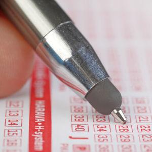 En penna på en tipskupong.