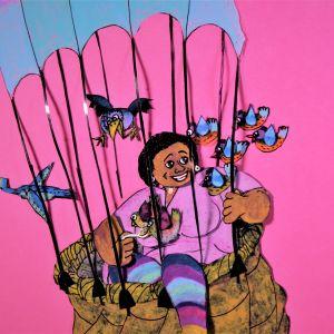 En ritad bild av en kvinna som sitter i en varmluftsballong omgiven av fåglar.