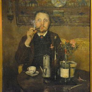 Porträtt av Ville Vallgren vid frukostbordet av Allan Österlind.