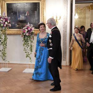 Kung Carl Gustaf och drottning Silvia före middagen på Presidentens slott den 1 juni 2017.