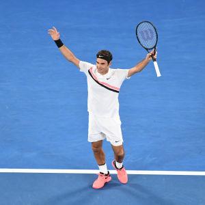 Roger Federer jublar efter sin 20:e seger i en grand slam-turnering.