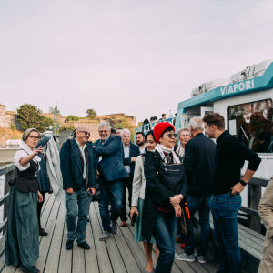 People disembarking from a ferry boat on the deck at Suomenlinna.