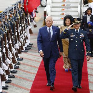 Najib Tun Razak  och Rosmah Mansor på röda mattan.