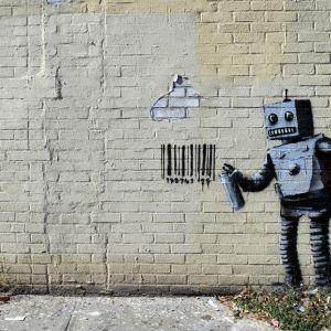 seinämaalaus, jossa robotti on spreijannut seinään viivakoodin