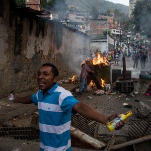 Protester i Venezuelas huvudstad Caracas efter ett mindre kuppförsök i januari 2019
