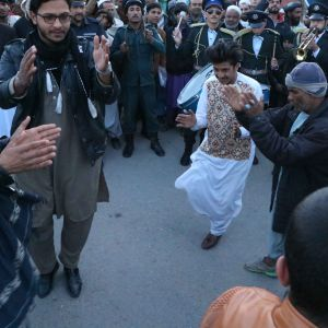 Afghaner över hela landet firade det veckolånga eldupphöret som började vid midnatt. Eldupphöret är det andra sedan kriget började för 18 år sedan.