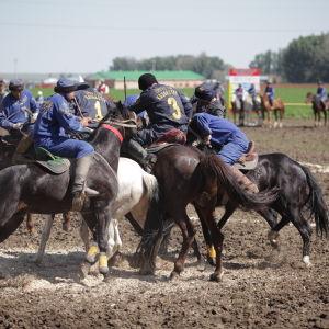 Buzkashi tai Kokpar on villi hevospoolo, jota pelataan vuohen ruholla Kazakstanissa.