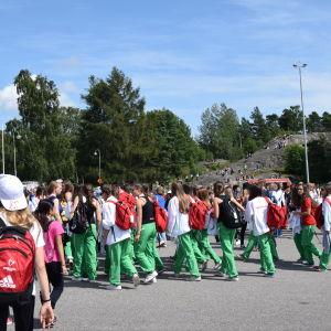 Deltagare utanför Olympiastadion.