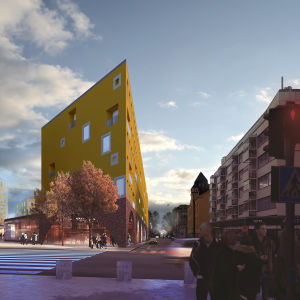 En gatukorsning med ett högt trekantigt hus i mitten.