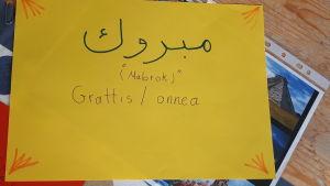 Grattis på arabiska.