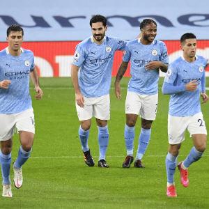 Glada miner i Manchester City i samband med lördagens seger mot Newcastle.