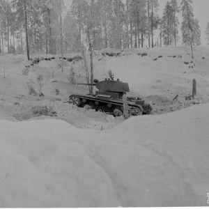 Kollaanjoen itäp. venäl. hv. etenee kiivaasti ampuen. 17-12-39.