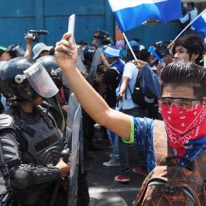 Demonstranter i Honduras