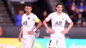 Thiago Silva och Edinson Cavani ser fundersamma ut.