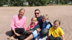 Familjen Roos på stranden