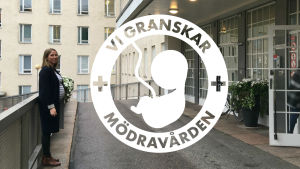 Gravid kvinna står framför Kvinnokliniken i Helsingfors.