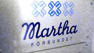 Marthaförbundets dörrskylt.