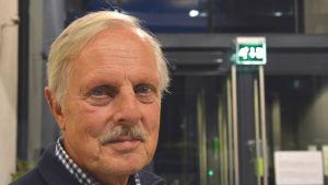 Jan-Åke Törnroos, en man med ljust hår och en grånande mustasch.