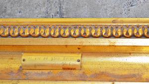 """""""Det var en gång betong"""", inskription på ram i TF:s nationshus."""