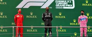 Lewis Hamilton (i mitten) vann, Sergio Perez (till höger) var tvåa och Sebastian Vettel (till vänster) trea.