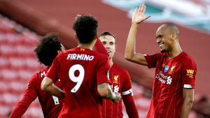 Fabinho (till höger) som firar sitt 3–0-mål dominerade stort på Liverpools mittfält.