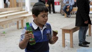 Judisk pojke vid El Ghribasynagogan på Djerba  vid Lag Baomer 2018.