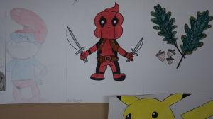 Teckningar som föreställer en smurf, en superhjälte och eklöv.