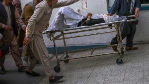 En man förs till vård efter en explosion nära en skola