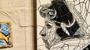 En tavla som föreställer en kvinna från mitten av 1900-talet.