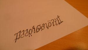 Skissen för ett Morgonöppet-ambigram!