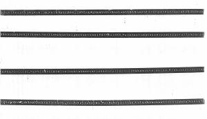Ett färgband från bombmannens skrivmaskin, med inpräntade övningsversioner av hotbrevet.
