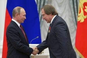 Venäjän presidentti Vladimir Putin ja muusikko Sergei Roldugin