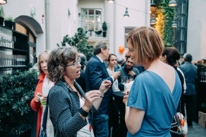 Two woman talking during a mingle.
