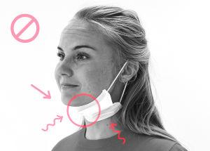 Bild på hur man inte ska bära munskydd. Skyddet är nerdraget under hakan.