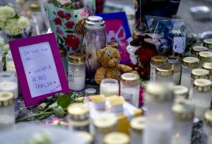 Blommor, ljus och en nallebjörn har förts till platsen där 12-åringen blev skjuten.