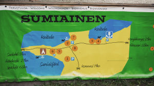 Piirretty suurikokoinen karttajuliste, jossa otsikko Sumiainen, piirretty kylän keskusta, mainittu Keitele, Sumiaisjärvi, etäisyyksiä lähikaupunkeihin